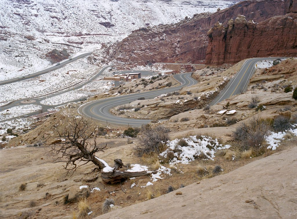 Arches National Park entrance station, looking down from the initial climb once entering the park. Highway 191 coming down from Crescent Junction may be seen towards the top left of the frame.